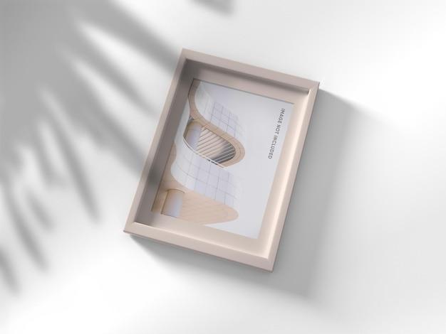 Maquete de moldura de foto em fundo branco