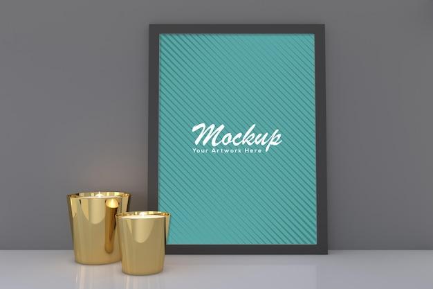 Maquete de moldura de foto preta vazia com copo de dois potes de vela de ouro