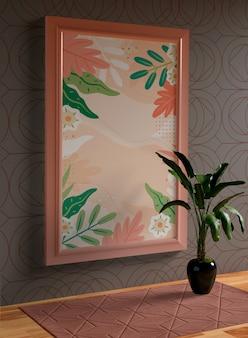 Maquete de moldura rosa minimalista pendurado na parede