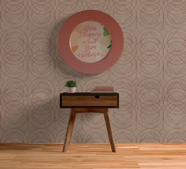 Maquete de moldura rosa redonda na parede