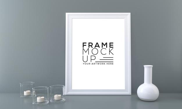 Maquete de moldura vertical com jarra de vidro e vaso de vela