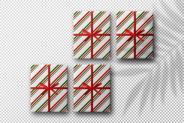 Maquete de natal com caixas de presente e sombra de folhas de palmeira