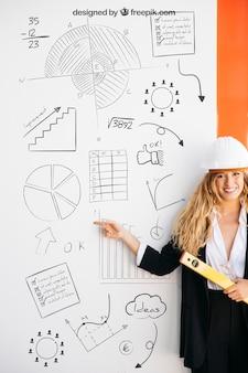 Maquete de negócios com mulher usando capacete