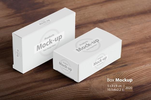 Maquete de pacotes de duas caixas de comprimidos na mesa de madeira