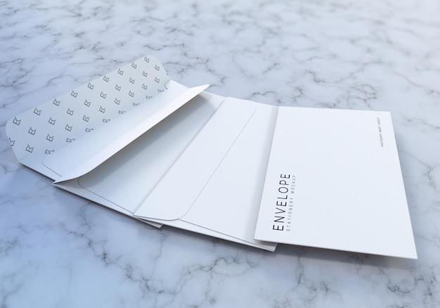 Maquete de papelaria envelope com fundo de textura de mármore Psd Premium