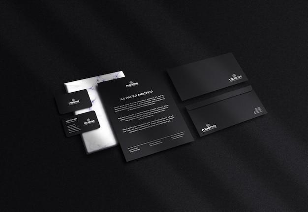 Maquete de papelaria escuro de luxo