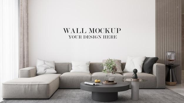 Maquete de parede atrás de um grande sofá moderno