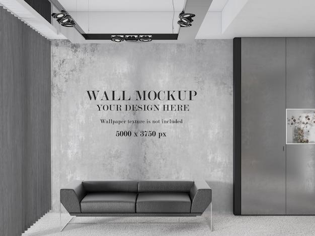 Maquete de parede atrás de um sofá cinza moderno
