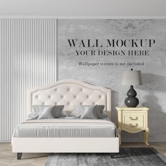 Maquete de parede atrás de uma cama elegante com móveis minimalistas