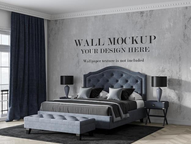 Maquete de parede atrás de uma luxuosa cama azul marinho
