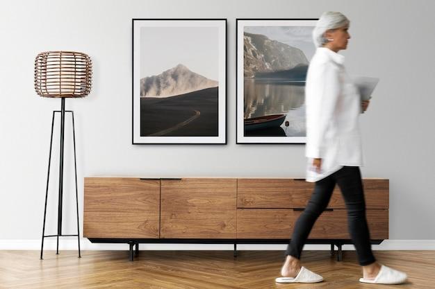 Maquete de parede de porta-retratos psd com gabinete de tv em uma sala de estar com decoração escandinava