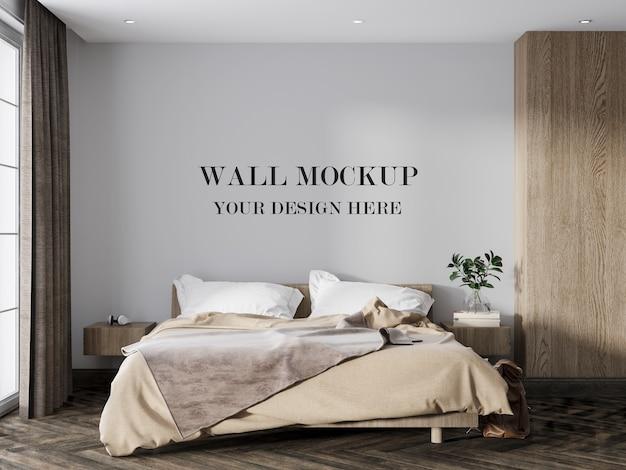 Maquete de parede em branco atrás de uma cama moderna