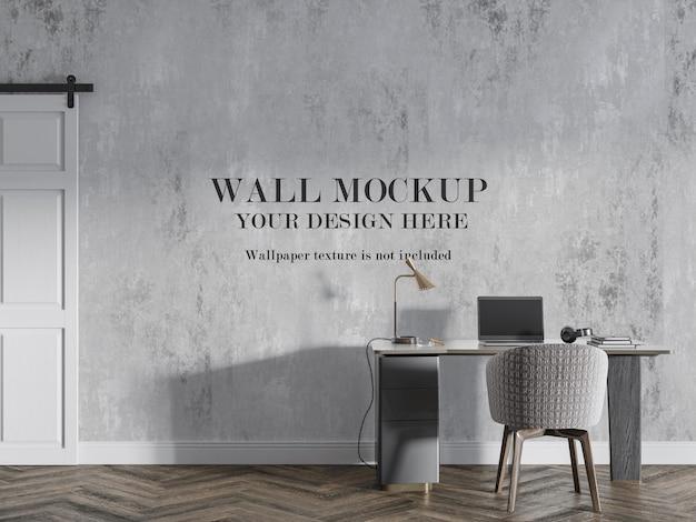 Maquete de parede em branco atrás de uma mesa moderna