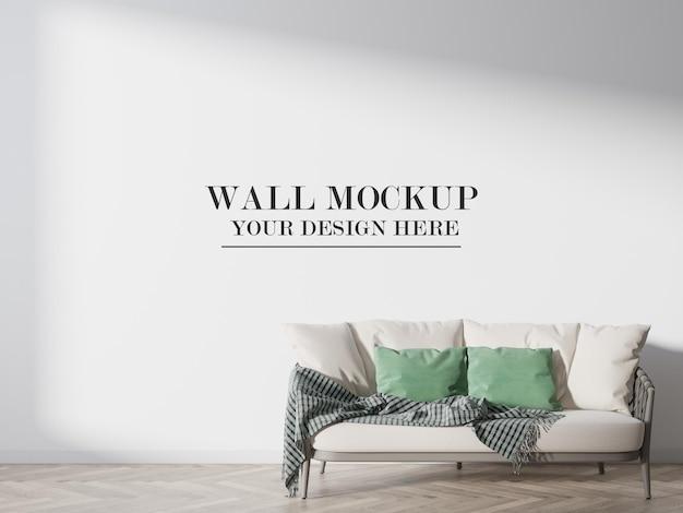 Maquete de parede em branco com renderização 3d atrás do sofá