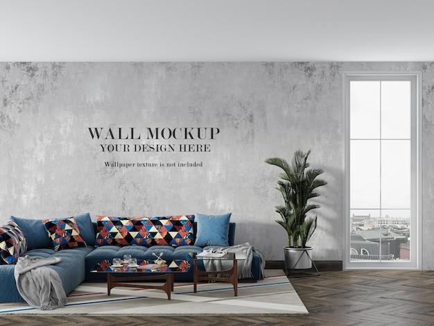 Maquete de parede em renderização 3d atrás do sofá azul