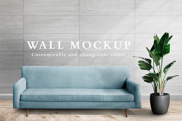 Maquete de parede psd com sofá azul na sala de estar