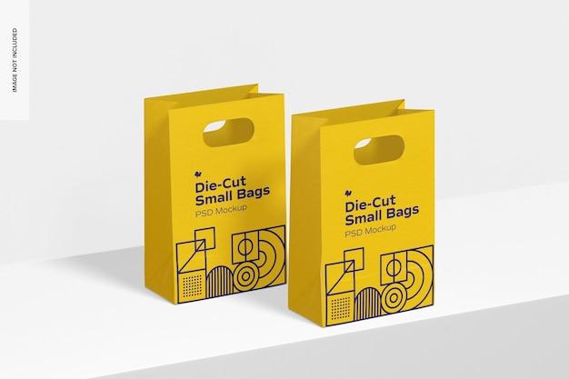 Maquete de pequenos sacos de papel cortados