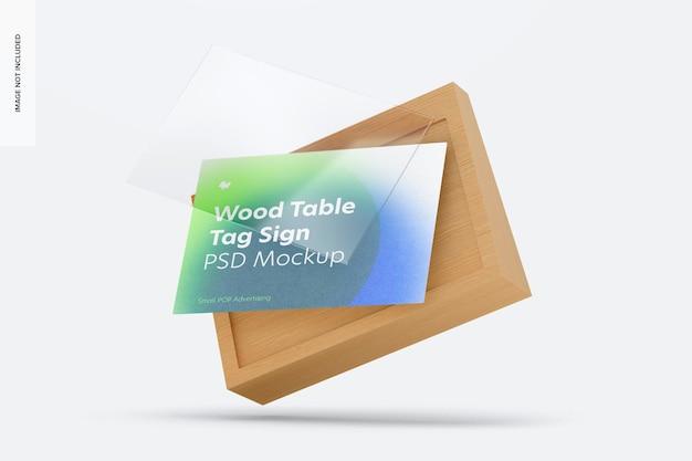 Maquete de placa de etiqueta de publicidade de mesa de madeira, caindo