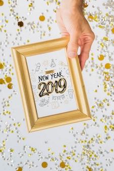 Maquete de quadro com decoração de ano novo