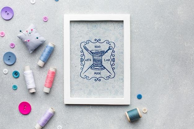Maquete de quadro com linha de costura