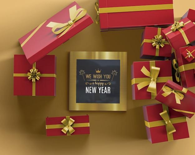 Maquete de quadro de ano novo com presentes