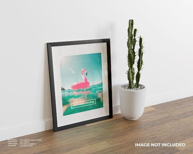 Maquete de quadro de arte em piso de madeira