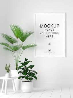 Maquete de quadro de foto em branco com planta no fundo da parede branca.