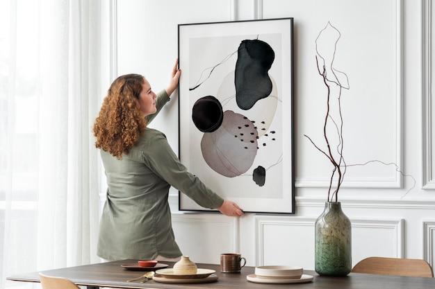 Maquete de quadro de imagem psd pendurado na parede design de interiores mínimo