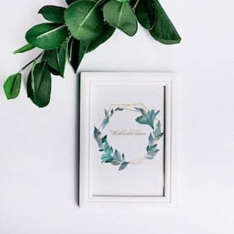 Maquete de quadro de primavera com folhas decorativas em vista superior