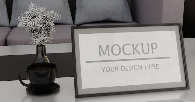 Maquete de quadro vertical na mesa da sala de estar com uma xícara de café