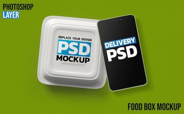 Maquete de renderização 3d de caixa e smartphone de alimentos