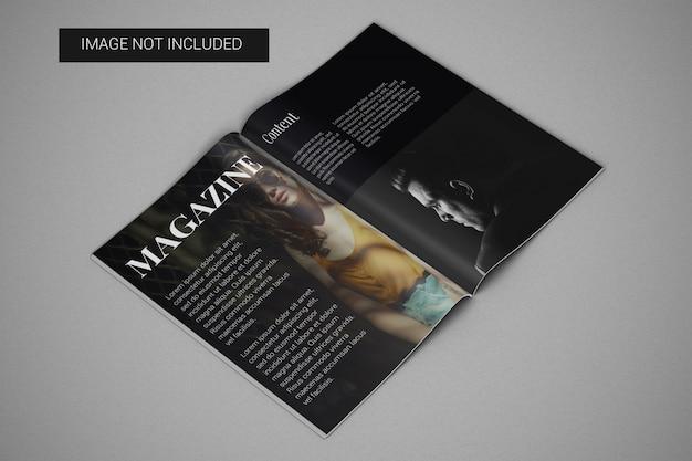 Maquete de revista a4 aberta na página central, vista esquerda