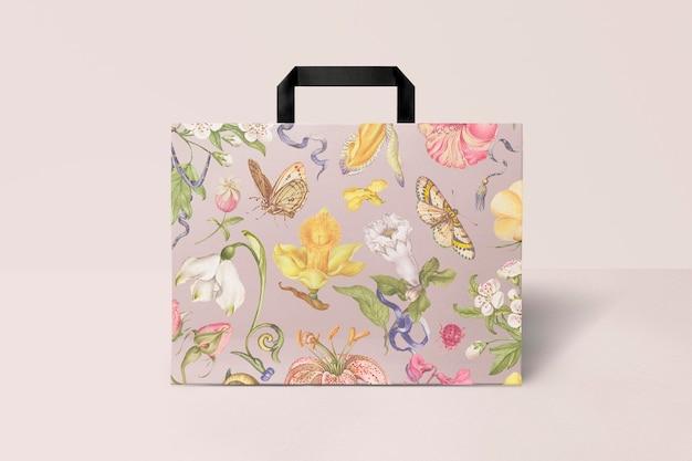 Maquete de sacola de compras de papel psd em estilo vintage de padrão floral rosa