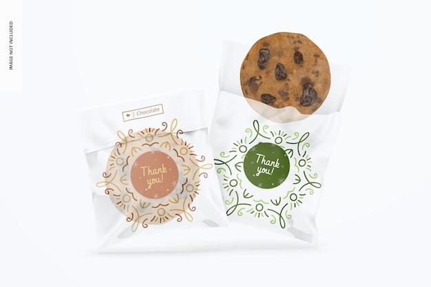 Maquete de sacos de biscoitos de celofane, caindo