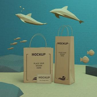 Maquete de sacos de papel do dia do oceano