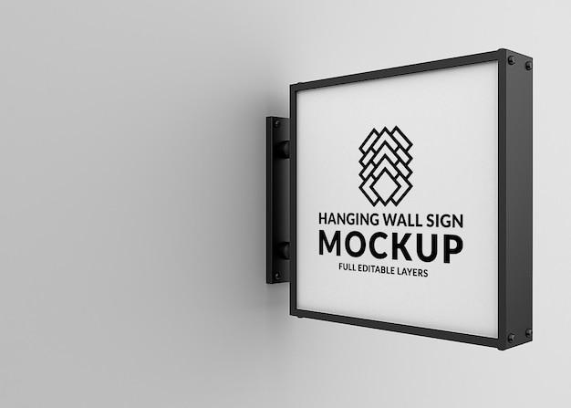 Maquete de sinalização suspensa na parede isolada