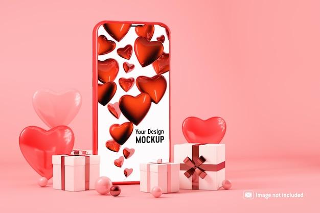 Maquete de smartphone com caixas de presente e corações