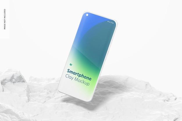 Maquete de smartphone de argila, caindo