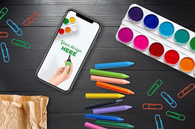 Maquete de smartphone e material escolar