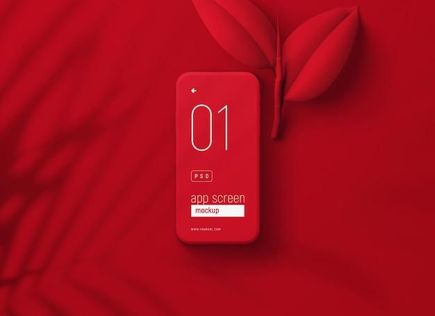 Maquete de smartphone vermelho com folhas vermelhas
