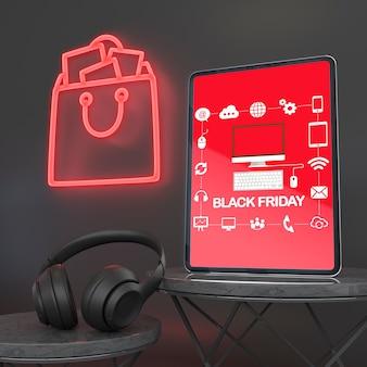Maquete de tablet com luzes de neon e fones de ouvido
