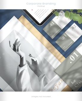 Maquete de tablet e maquete de marca corporativa com sobreposições de sombra de folha