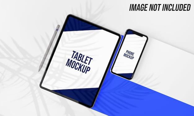 Maquete de tablet e telefone com sombra de folhas de palmeira