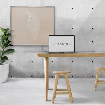 Maquete de tela do laptop psd e moldura em branco na sala de estar