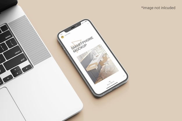 Maquete de tela do smartphone ao lado de um laptop