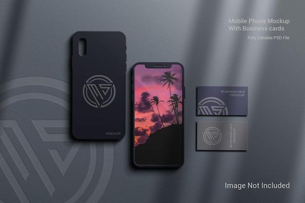 Maquete de telefone celular com cartões de visita