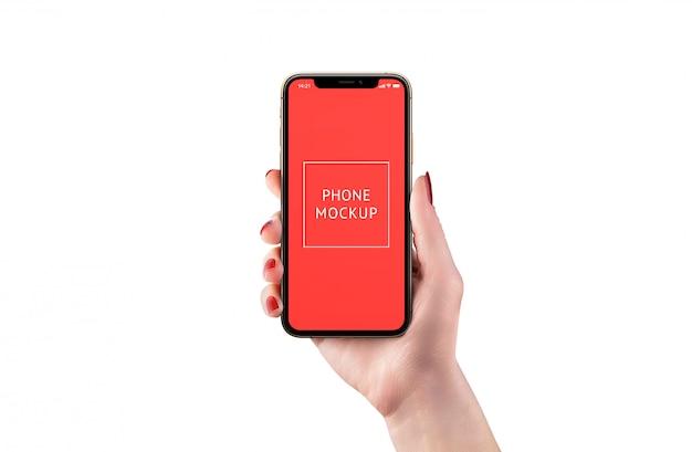 Maquete de telefone moderno isolado na mão da mulher. posição frontal. exibição de objeto inteligente para apresentação do design do aplicativo.