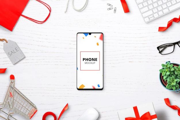 Maquete de telefone na mesa com itens de compras