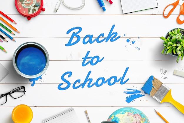 Maquete de texto ou logotipo pintada com um pincel em uma mesa de madeira branca. criador de cenas com camadas separadas de material escolar. vista superior, configuração plana, composição