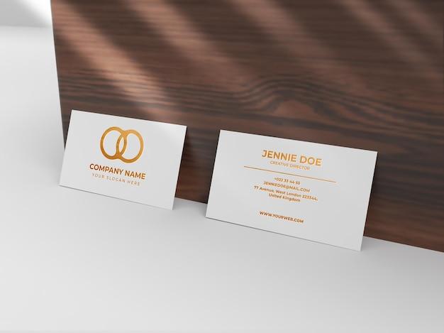 Maquete de textura brilhante dourada com dois cartões de visita
